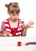 Little girl draws paints — Stock Photo