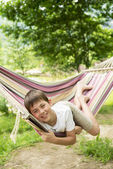 Boy in a hammock on the nature — Stock Photo