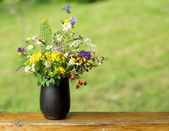 Beautiful bouquet of bright wildflowers — Stock Photo