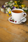 Cup of aromatic tea — Stock Photo