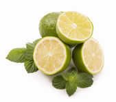 Fresh limes, mint leaves — Stock Photo