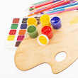 Palette of the artist, paint, pencils — Stock Photo