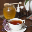 Still life from medicinal herbs, honey, herbal tea and medicines — Stock Photo