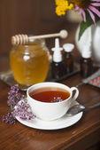 Still life from medicinal herbs, honey, herbal tea and medicines — Stock Photo