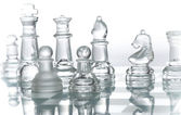 Transparent glass chess — Stock Photo