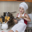 Girl in a cap and an apron — Stock Photo