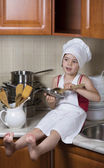 Girl in a cap and an apron — Stok fotoğraf