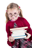 Ittle girl wearing spectacles holds books — Stock Photo