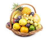 Fresh fruit in a wicker basket — Stock Photo