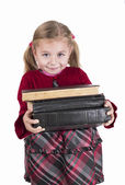 Little girl holding books — Stock Photo
