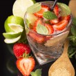 Alcoholic punch cocktail with ice and strawberry — Stock Photo