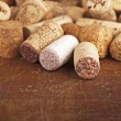 Stock Photo: Bottle corks on wooden background