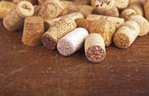 Bottle corks on the wooden background — Stock Photo