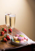 Wine or champagne with  macaroons — Stock Photo