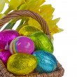 Royalty-Free Stock Photo: Easter eggs with a wicker basket with daffodils.
