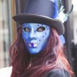 Stock Photo: Young female in blue mask.