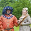 Richly dressed man and woman in medieval costume. — Stock Photo