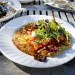Potato rosti with smoked salmon served alfresco. — Stock Photo