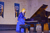 World famous classical pianist Gulsin Onay at a concert in Bellapais Abbey in North Cyprus. — Stock Photo
