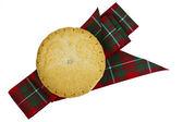 Mince pie and tartan ribbon. — Stock Photo