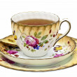 Tea in an antique china cup with saucer and dessert plate. — Photo