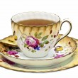 Tea in an antique china cup with saucer and dessert plate. — 图库照片