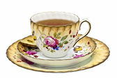Tea in an antique china cup with saucer and dessert plate. — Stock Photo