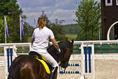 Female horse rider at showjumping event. — Zdjęcie stockowe