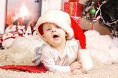Little happy Christmas girl in santa's hat — Stock Photo