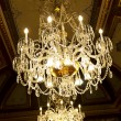 Chandelier hanging under a ceiling in a palace — Stock Photo