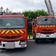 Three fire trucks parked - Stock Photo