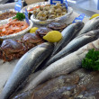 Raw fish on market counter — Stock Photo #12222207