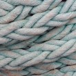 Thick rope on the ship - Stock Photo
