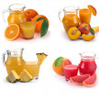 Set glass and jug of fruits juice — Stock Photo