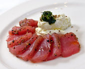 Tuna carpaccio with cheese garlic and basil — Stock Photo