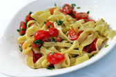 Pasta with cherry tomatoes and basil — Stock Photo