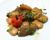 Roast lamb with beans — Stock Photo