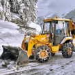 Foto de Stock  : Clearing roads of snow and fallen tree