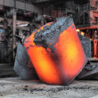 Steel ingot in the workspace - Stock Photo