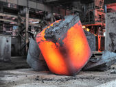 Steel ingot in the workspace — Stock Photo