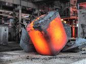 Steel ingot in the workspace — Stock Photo