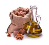 Walnut oil with nuts — Stock Photo
