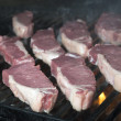 Stock Photo: Beef steak raw on open flame grill