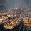 Stock Photo: Beef steak cooking on open flame grill