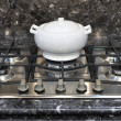 Stock Photo: Ceramic pot on a gas stove
