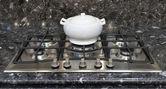 Ceramic pot on a gas stove — Stock Photo