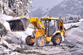Clearing roads of snow and fallen tree — Stock Photo