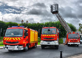 Three fire trucks parked — Stock Photo