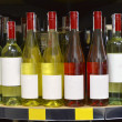Stock Photo: Red and white wine in bottles