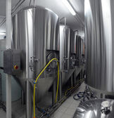 Row of tanks in microbrewery — Stock Photo